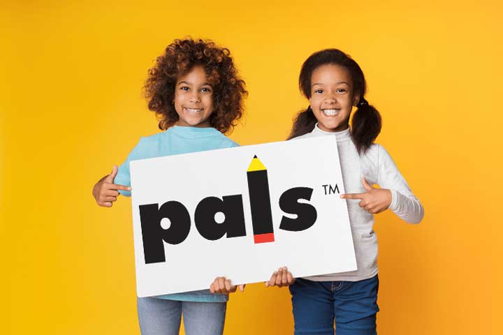 Two girls holding a paper sign with the PALS logo.