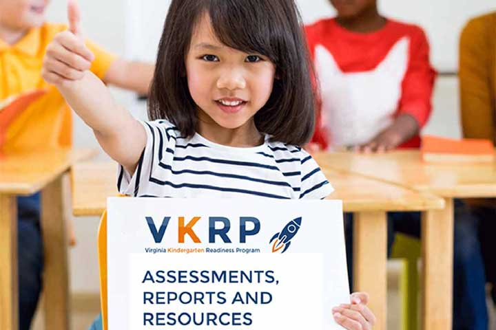 girl showing a thumbs up sign holding poster of VKRP assessments, reports, and resources