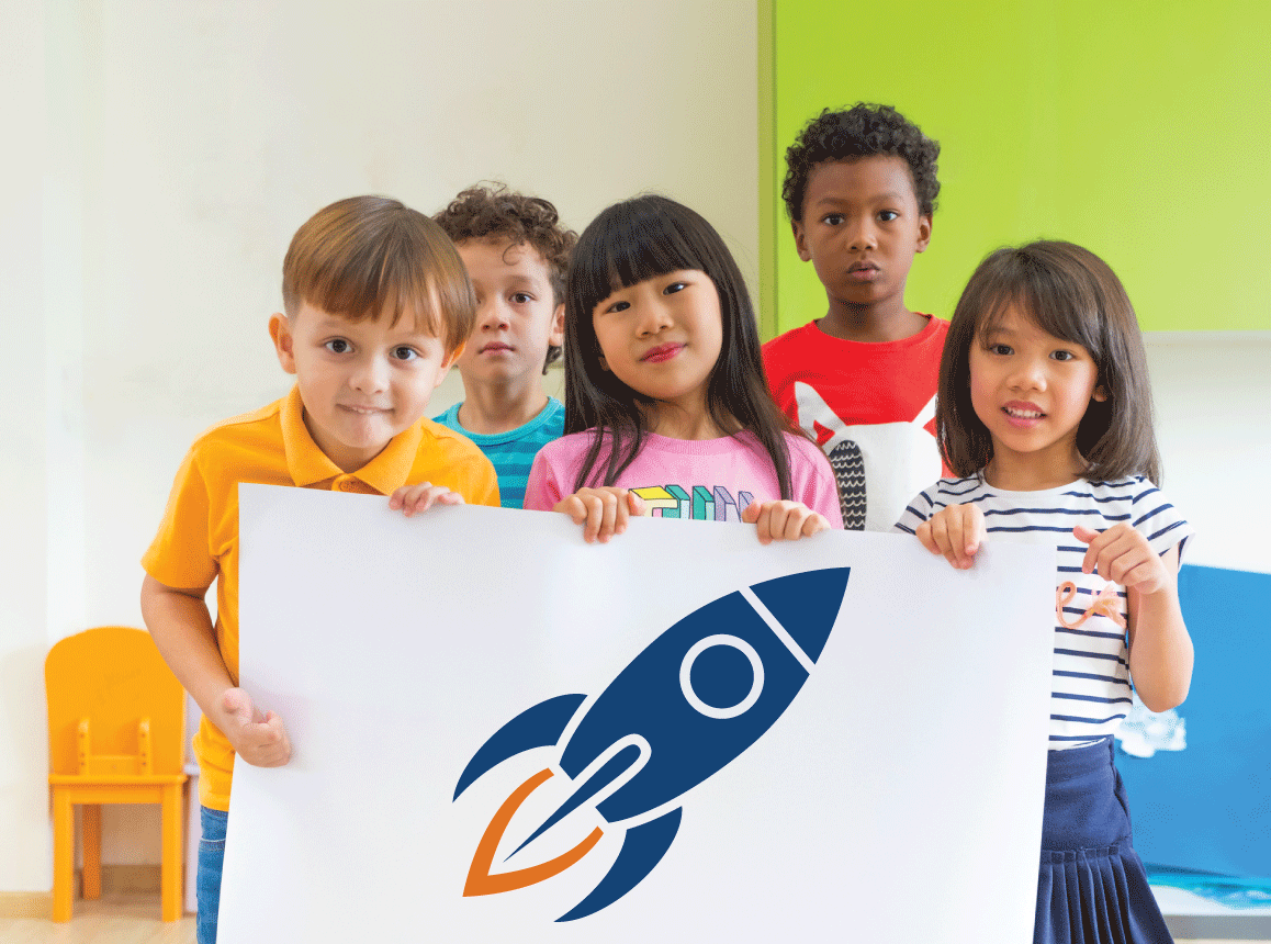 Diverse group of children holding poster with rocket graphic