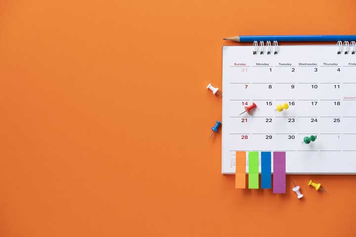 close up of calendar on the orange table background