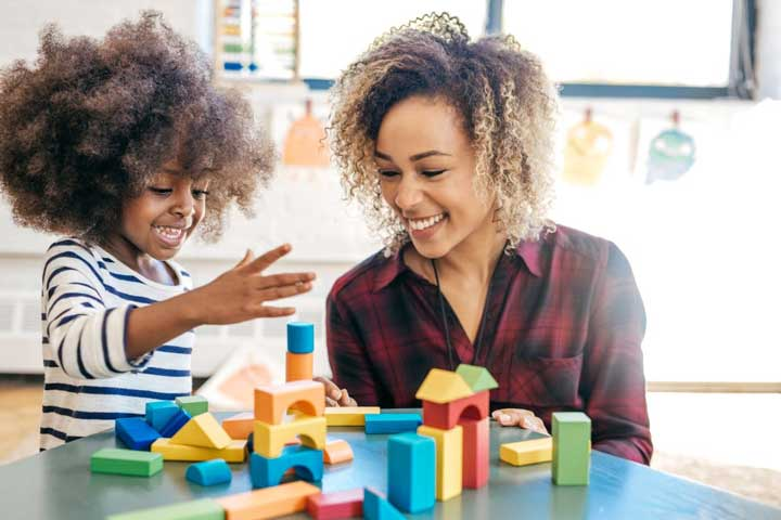 Teacher and child building with blocks