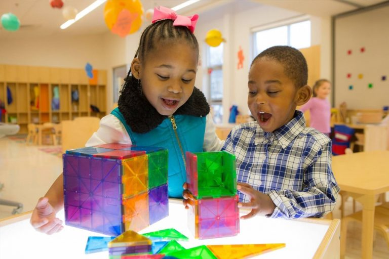 children playing with magnatiles